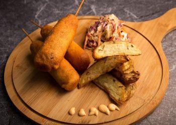 Vegan Corn Dog with Potato Wedges and Crunchy Slaw